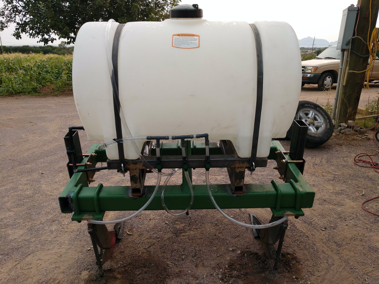 A contour line plow with holding tank and inoculation pump/tubes